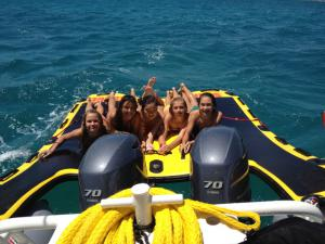 Girls love inflatable boat sleds