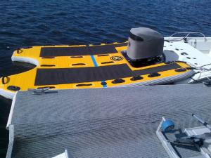 Single outboard with inflatable boat sled